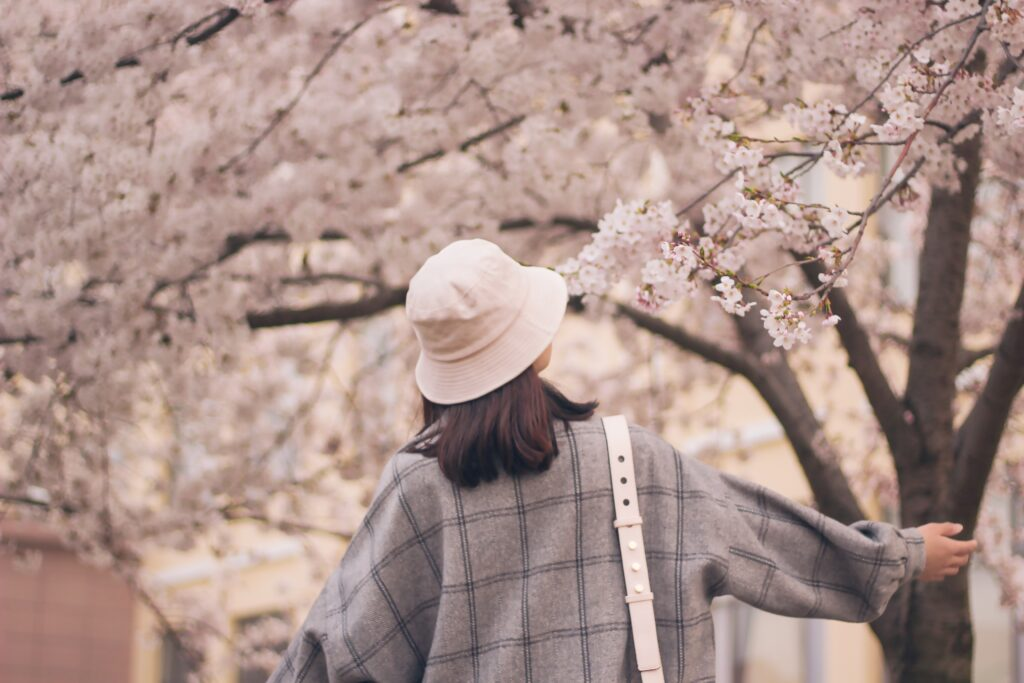 Lady walking in the park as an outdoor activity